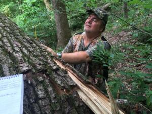 Ken Stewart investigating and documenting the tree that broke while on the phone with me during Tenacity Echo.